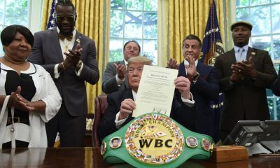 Jack Johnson's great-great niece Linda Haywood (L) joined Deontay Wilder, Keith Frankel, Sylvester Stallone and Lennox Lewis as President Donald Trump pardoned the legendary boxer. (AP)