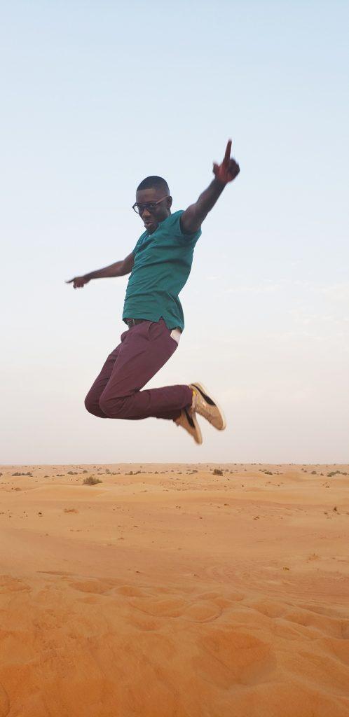 Jumping on the dunes of the Arabian Adventures' Desert safari