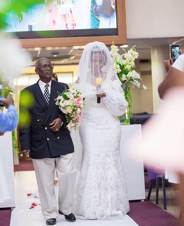 Sandra Walks down the aisle with her father