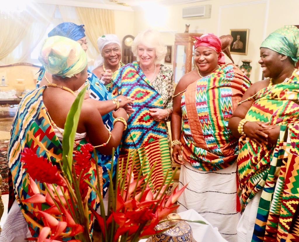 The Duchess is presented with Kente robes at a tea with the King's spouse Lady Julia. Traditionally only woven by men, Kente cloth is contains a lot of symbolism and the colours have various meanings.