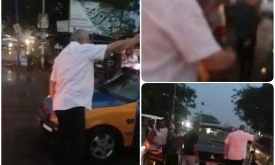Former president Rawlings controls traffic in Prampram